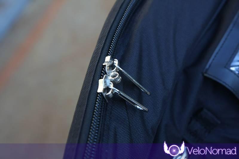 Main zips with padlock holes